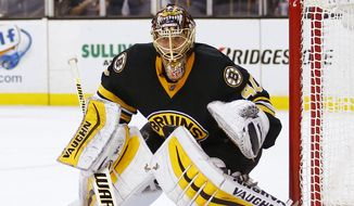 Boston Bruins goalie Tuukka Rask watches the action during the first period of an NHL hockey game against the Winnipeg Jets in Boston in this Nov. 28, 2014, file photo. (AP Photo/Winslow Townson)