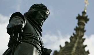 The statue of Oliver Cromwell is seen during a ceremony to mark the 350th anniversary of his death as Lord Protector of England in 1658, during a ceremony outside the Place of Westminster, in central London, Wednesday Sept. 3, 2008. (AP Photo/Lefteris Pitarakis, pool)