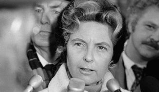 Phyllis Schlafly of Alton, Ill., in Chicago on Wednesday, Dec. 7, 1977, says that she won?t seek the U.S. Senate seat held by Charles H. Percy, also a Republican, in the March 21 primary. Mrs. Schlafly, allied with several conservative causes, conducted the press conference outdoors in Chicago?s subfreezing weather. (AP Photo)