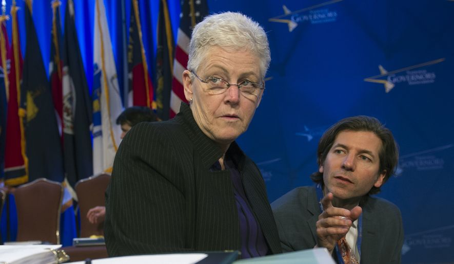 Environmental Protection Agency (EPA) Administrator Gina McCarthy confers with an aide as she prepares to address the Natural Resources Committee session during the National Governors Association Winter Meeting in Washington, Sunday, Feb. 22, 2015. (AP Photo/Cliff Owen) ** FILE **