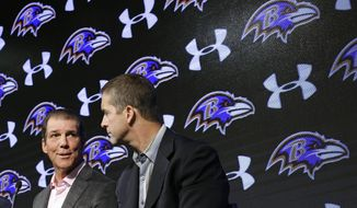 Baltimore Ravens owner Steve Bisciotti, left, looks toward head coach John Harbaugh as he speaks at an NFL football news conference, Tuesday, Feb. 24, 2015, in Owings Mills, Md. The team held the news conference to review the 2014 season and discuss the upcoming season. (AP Photo/Patrick Semansky)