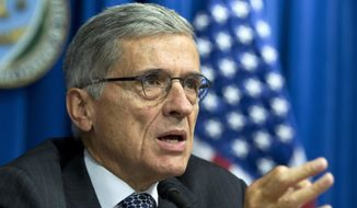 Federal Communications Commission (FCC) Chairman Tom Wheeler speaks during new conference in Washington in this Oct. 8, 2014, file photo. (AP Photo/Jose Luis Magana, File)