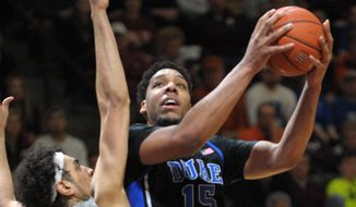 Duke's Jahill Okafor (15) goes up for a basket against Virginia Tech's Satchel Pierce during the first half of an NCAA college basketball game Wednesday Feb. 25, 2015, in Blacksburg, Va. (AP Photo/Don Petersen)