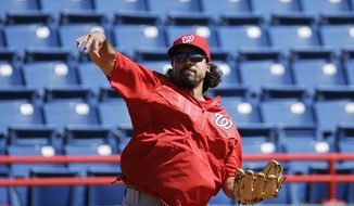 Washington Nationals' Anthony Rendon throws to first base while fielding ground balls during a spring training baseball workout, Sunday, Feb. 22, 2015, in Viera, Fla. (AP Photo/David Goldman)