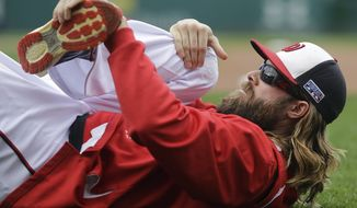 Washington Nationals right fielder Jayson Werth (28) warms up before Game 2 of baseball's NL Division Series against the San Francisco Giants at Nationals Park, Saturday, Oct. 4, 2014, in Washington. (AP Photo/Patrick Semansky)