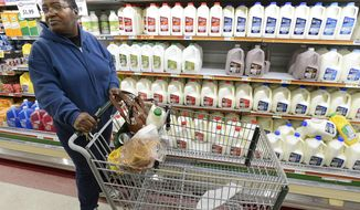 Susie Brackins makes an early morning shopping run to Lucky's Supermarket in Decatur, Alabama, for bread, milk, eggs and ingredients for soup in anticipation of the afternoon prediction of 3-5 inches of snow. The National Weather Service has issued a winter storm warning for Wednesday for north Alabama. (AP Photo/The Decatur Daily, John Godbey)