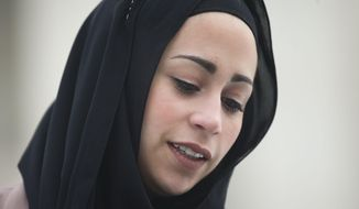 Samantha Elauf stands outside the Supreme Court in Washington, Wednesday, Feb. 25, 2015. The Supreme Court is indicating it will side with a Muslim woman who didn't get hired by clothing retailer Abercrombie & Fitch because she wore a black headscarf that conflicted with the company's dress code to her job interview. Liberal and conservative justices aggressively questioned the company's lawyer during arguments at the high court Wednesday in a case that deals with when an employer must take steps to accommodate the religious beliefs of a job applicant or worker.  (AP Photo/Pablo Martinez Monsivais)