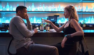 "Will Smith and Margot Robbie (right) appear in a scene from ""Focus."" (AP Photo/Warner Bros. Pictures, Frank Masi)"