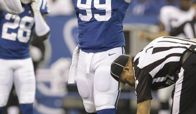 Indianapolis Colts nose tackle Ricky Jean Francois encourages the fans during the first half of a NFL football game against the Oakland Raiders in Indianapolis, Sunday, Sept. 8, 2013. (AP Photo/Michael Conroy)