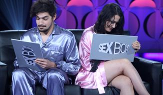 "This image released by WeTV shows contestants Elle, right, and Brandon during a taping of the new relationship therapy series ""Sex Box,"" airing Friday at 10 p.m. EST. (AP Photo/WeTV)"