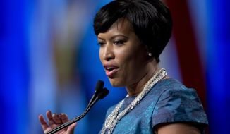 D.C. Mayor Muriel Bowser speaks Jan. 2, 2015, after taking the oath of office at the District of Columbia Mayoral Inauguration ceremony at the Convention Center in Washington. (Associated Press) **FILE**