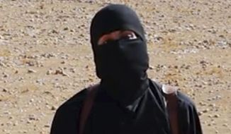 Mohammed Emwazi, the British member of the Islamic State group known as Jihadi John, appears in a beheading video released by the terrorist organization. (Associated Press) ** FILE **