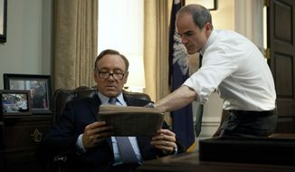 "In this image released by Netflix, Kevin Spacey, left, and Michael Kelly appear in a scene from ""House of Cards."" The third season of the political drama will be available on Netflix on Friday Feb. 27, 2015. (AP Photo/Netflix)"