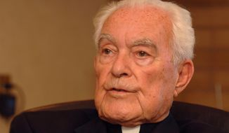 The Rev. Theodore Hesburgh, C.S.C, president emeritus of the University of Notre Dame, talks about his experiences over 90 years of life at his desk in the Hesburgh Library on the campus of the University of Notre Dame in South Bend, Ind., in this Sept. 24, 2007, file photo. (AP Photo/Joe Raymond, File)