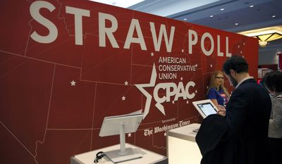 Attendees vote in the CPAC 2015 Straw Poll at the Conservative Political Action Conference (CPAC) in Friday, Feb. 27, 2015, in National Harbor, Md. (AP Photo/Alex Brandon)