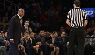 Georgetown head coach John Thompson III, left, argues a call with a referee during the first half of an NCAA college basketball game against St. John's, Saturday, Feb. 28, 2015, at Madison Square Garden in New York.  (AP Photo/Mary Altaffer)