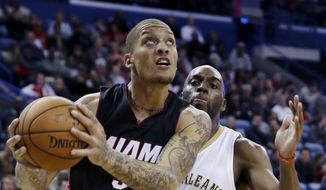 Miami Heat forward Michael Beasley (30) goes to the basket in front of New Orleans Pelicans guard Quincy Pondexter (20) during the first half of an NBA basketball game in New Orleans, Friday, Feb. 27, 2015. (AP Photo/Gerald Herbert) **FILE**