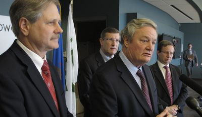 Gov. Jack Dalrymple, flanked by other North Dakota Republicans, say it's time to spend tax money, even after reducing the state's two-year budget by $4 billion. (Associated Press)