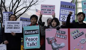 "Protesters shout slogans to denounce the annual joint military exercises, dubbed Key Resolve and Foal Eagle, between South Korea and the United States, during a rally near U.S. Embassy in Seoul, South Korea, Monday, March 2, 2015. North Korea on Monday fired two short-range ballistic missiles into the sea and warned of ""merciless strikes"" against its enemies as allies Seoul and Washington launched annual military drills Pyongyang claims are preparation for a northward invasion. The sign read "" Stop Military Drill."" (AP Photo/Lee Jin-man)"