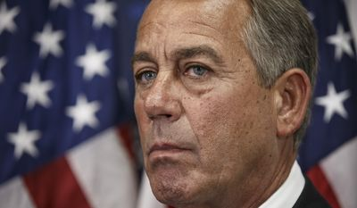 """Remember what's causing this, it's the president of the United States overreaching and it's not just on immigration,"" House Speaker John A. Boehner said on CBS's ""Face the Nation."" (Associated Press)"