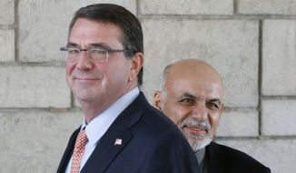Afghan President Ashraf Ghani (right) is courting a longer stay by U.S. troops, whom he thanks for their sacrifices. Last month, he stood shoulder to shoulder at the presidential palace with Defense Secretary Ashton Carter. (Associated Press)