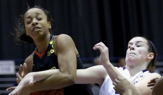 Maryland guard Lexie Brown, left, battles for a rebound against Northwestern guard Maggie Lyon, right, during the second half of an NCAA college basketball game on Sunday, March 1, 2015, in Evanston, Ill. Maryland  won 69-48. (AP Photo/Nam Y. Huh)