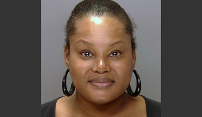 """This undated file photo provided by the Philadelphia Police Department shows Padge Gordon, also known as Padge Victoria Windslowe. Windslowe, an aspiring hip-hop artist who boasts about her talent for underground """"body sculpting,"""" has one last chance to impress a jury before the panel weighs murder charges against her in a dancer's death. Windslowe has been testifying since Thursday, Feb. 26, 2015, and faces more cross-examination this week. (AP Photo/Philadelphia Police Department, File)"""