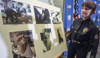 Los Angeles Police detective Meghan Aguilar explains images released by police that could indicate evidence of a suspect holding a police officer's gun, seen in a video shot by a witness at the scene of the shooting of a homeless man on Skid Row of Los Angeles, top row left, at a news conference at police headquarters Monday, March 2, 2015. (AP Photo/Damian Dovarganes)