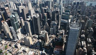 The New York Times building, lower right, and midtown Manhattan are shown in this aerial photo of Sept. 8, 2008 in New York. (AP Photo/Mark Lennihan)