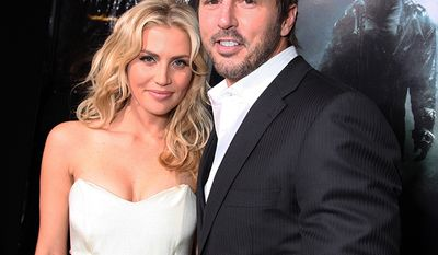 Willa Ford and Mike Modano at New Line Cinema and Paramount Pictures Los Angeles Premiere of 'Friday The 13th' on February 09, 2009 at the Grauman's Chinese Theatre in Hollywood, California. (Photo by Eric Charbonneau/Invision/AP Images)