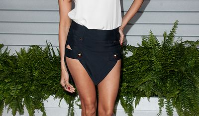 Noureen DeWulf (Vancouver Canucks' goaltender Ryan Miller) arrives at the MAXIM Hot 100 Party on Tuesday, June 10, 2014 in West Hollywood, Calif. (Photo by Richard Shotwell/Invision/AP)