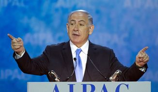 Israeli Prime Minister Benjamin Netanyahu gestures while speaking at the 2015 American Israel Public Affairs Committee (AIPAC) Policy Conference in Washington, Monday, March 2, 2015. (AP Photo/Cliff Owen)