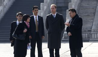 Britain's Prince William (second from the right, Duke of Cambridge, is accompanied by a museum officer (right) during a visit to the Forbidden City in Beijing, China, on March 2, 2015. (AP Photo/Rolex Dela Pena, Pool)