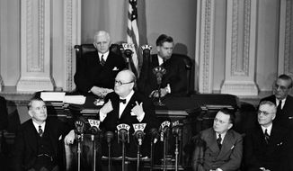 FILE - In this Dec. 26, 1941 file photo, British Prime Minister Winston Churchill addresses a joint session of the on Capitol Hill in Washington. Given anywhere else, Israeli Prime Minister Benjamin Netanyahu's speech Tuesday wouldn't cause such a fuss. But a foreign leader denouncing U.S. policy from within the grand hall of American democracy upends nearly two centuries of tradition. A joint meeting of Congress, gathering senators and representatives together in the House chamber, is a ceremony typically bestowed on one or two friendly foreign leaders per year. It looks a lot like a presidential State of the Union address. The speaker embodies his or her nation; the audience of lawmakers represents all American. Behind him on the senate rostrum sat Rep. William P. Cole, Jr., speaker pro-tem, left, and Vice President Henry A. Wallace, right.  (AP Photo, File)