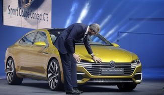Heinz-Jakob Neuber, member of the board of management for Volkswagen brand, presents the new Volkswagen Sport Concept GTE during a preview show of Volkswagen Group, as part of the 85th Geneva International Motor Show, Switzerland, Monday, March 2, 2015. (AP Photo/Laurent Cipriani) ** FILE *
