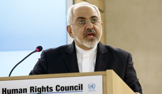 Iranian Foreign Minister Mohammad Javad Zarif delivers a speech during a session of the Human Rights Council, at the European headquarters of the United Nations, in Geneva, Switzerland, Monday, March 2, 2015. (AP Photo/Keystone,Salvatore Di Nolfi)