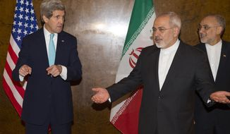 US Secretary of State John Kerry, left, discusses seating arrangements for a meeting with Iranian Foreign Minister Mohammad Javad Zarif for a new round of nuclear negotiations on Monday, March 2, 2015, in Montreux, Switzerland. (AP Photo/Evan Vucci)