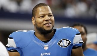 FILE - This is a Jan. 4, 2015, file photo showing Detroit Lions' Ndamukong Suh smiling as he walks across the field during warm ups before an NFL football game against the Dallas Cowboys in Arlington, Texas. Ndamukong Suh can test the open market when free agency begins March 10 after the Lions decided not to use the franchise tag on the star defensive tackle, according to a report on the team's website. (AP Photo/Tony Gutierrez, File)