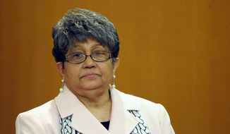 In this Friday, May 3, 2013, file photo, former Atlanta Public Schools Superintendent Beverly Hall stands as her attorney presents a motion at the Fulton County Superior Court hearing for several dozen Atlanta Public Schools educators facing charges alleging a conspiracy of cheating on the CRCT standardized tests in Atlanta. Hall, the former superintendent of Atlanta Public Schools charged in what prosecutors had called a broad conspiracy to cheat on state exams, has died, her attorney said Monday, March 2, 2015. (AP Photo/David Tulis, File)