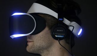 Marcus Ingvarsson tests out the PlayStation 4 virtual reality headset Project Morpheus in a demo area at the Game Developers Conference 2014 in San Francisco. (Associated Press)