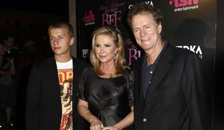 "In this Sept. 30, 2008, file photo, Conrad Hilton, left, Kathy Hilton, center, and Rick Hilton arrive at the launch party of new MTV series ""Paris Hilton's My New BFF"" in Los Angeles. Federal prosecutors in Los Angeles say Paris Hilton's brother Conrad has agreed to plead guilty to assaulting flight attendants on a trip from London last year. (AP Photo/Matt Sayles, File)"