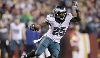 FILE - In this Dec. 20, 2014, file photo, Philadelphia Eagles running back LeSean McCoy carries the ball during an NFL football game against the Washington Redskins in Landover, Md. A person familiar with the deal says the Eagles have agreed to trade star running back McCoy for Buffalo Bills linebacker Kiko Alonso. The person spoke under condition of anonymity Tuesday night, March 3, 2015, because the teams had not announced the deal. (AP Photo/Patrick Semansky, File)