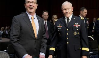 Defense Secretary Ash Carter and Joint Chiefs Chairman Gen. Martin Dempsey arrive on Capitol Hill in Washington, Tuesday, March 3, 2015, to testify before the Senate Armed Services Committee hearing to review the defense authorization request for fiscal 2016 and the future years defense program.   (AP Photo/Manuel Balce Ceneta)