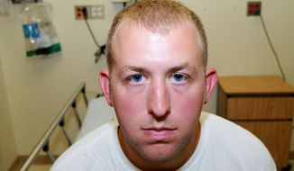 This 2014 file photo provided by the St. Louis County Prosecuting Attorney's office shows Ferguson Police Officer Darren Wilson during his medical examination after he fatally shot Michael Brown in Ferguson, Mo. (AP Photo/St. Louis County Prosecuting Attorney's Office, File)