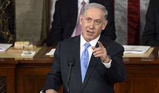 "Addressing a joint meeting of Congress in Washington, Israeli Prime Minister Benjamin Netanyahu said an emerging U.S.-Iran deal would ""all but guarantee"" Tehran will get nuclear weapons. (AP Photo/Susan Walsh)"