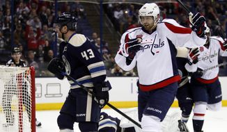 Washington Capitals' Eric Fehr, right, begins to celebrate his goal as Columbus Blue Jackets' Scott Hartnell, left, skates past during the first period of an NHL hockey game Tuesday, March 3, 2015, in Columbus, Ohio. (AP Photo/Paul Vernon)