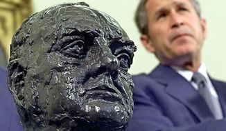 WASHINGTON, UNITED STATES:  US President George W. Bush listens to journalists' questions after receiving a bust of Sir. Winston Churchill from the British Ambassador at the Oval Office of the White House in Washington, DC 16 July 2001.     AFP PHOTO/TIM SLOAN (Photo credit should read TIM SLOAN/AFP/Getty Images)