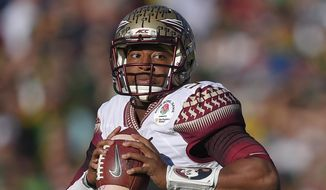 FILE - In this Jan. 1, 2015 file photo, Florida State quarterback Jameis Winston looks to throw during the first half of the Rose Bowl NCAA college football playoff semifinal against Oregon in Pasadena, Calif. Jameis Winston met with the Tampa Bay Buccaneers, Tuesday, March 3, 2015, hoping to make a good impression on the team considering taking the Heisman Trophy-winning quarterback with the first pick in the NFL draft. (AP Photo/Mark J. Terrill, File)