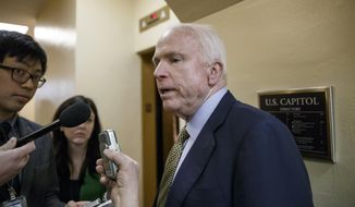 Senate Armed Services Committee Chairman John McCain, R-Ariz., speaks to reporters as he heads to the chamber for a procedural vote at the Capitol in Washington, Monday, March 2, 2015. (AP Photo/J. Scott Applewhite)