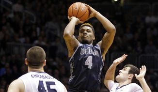 Georgetown guard D'Vauntes Smith-Rivera (4) shoots between Butler forward Andrew Chrabascz (45) and guard Alex Barlow (3) in the second half of an NCAA college basketball game in Indianapolis, Tuesday, March 3, 2015. Georgetown won 60-54. (AP Photo/Michael Conroy)